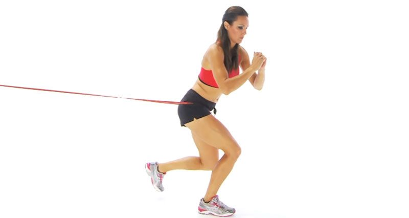 Knee exercise - resistance band hopping