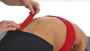 Preventing back pain Kinesiology taping
