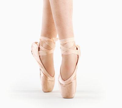 en pointe ballet dancer up on her toes