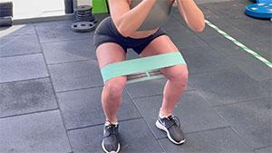 Glute band squat activation exercise knee rehabilitation